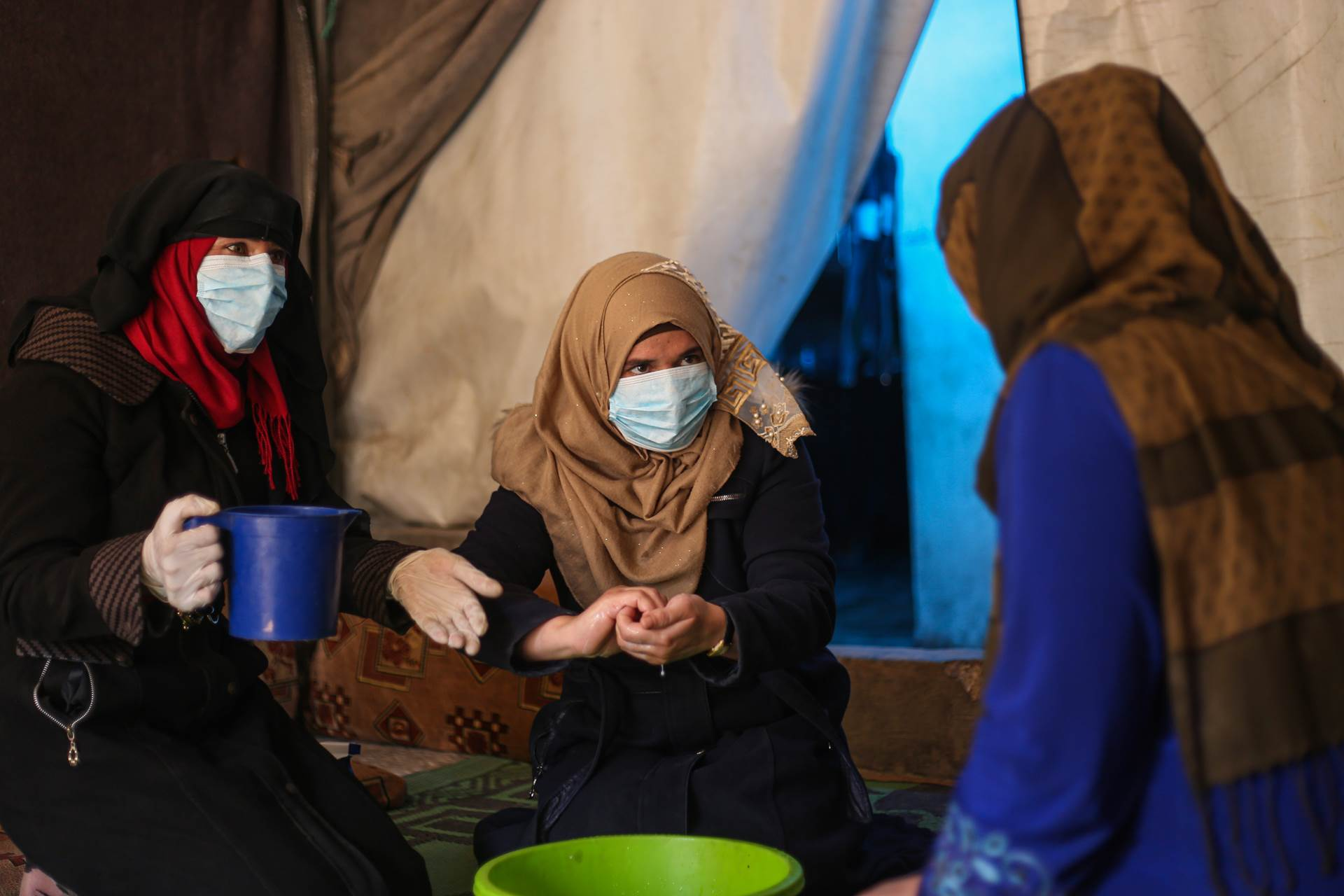 Eutur Nafra (left) is one of a number of women, working to raise community awareness regarding COVID-19 at the Abnaa Mhin IDP camp in northern Idleb Governorate. Displaced from Homs herself, she knows all too well the challenges of staying safe at this time. - mynd
