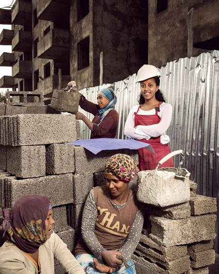 Helina, (center), 25, works for a real estate construction firm in Addis Ababa, the capital of Ethiopia. She is overseeing the construction of three apartment buildings